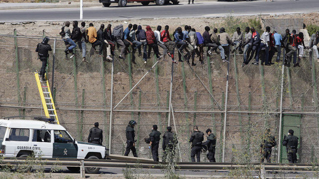 Refugess at border in Melilla
